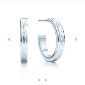 Tiffany logo earrings- barely worn